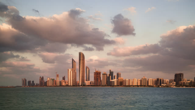 tl/ day to night time lapse of the abu dhabi skyline, and financial district, with the arabian sea in foreground - martin luther: his life and time stock videos & royalty-free footage