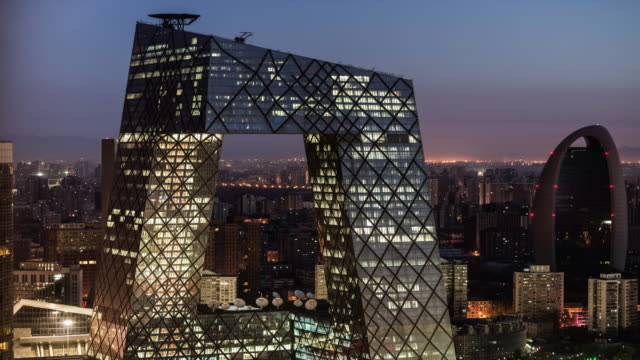 day to night time lapse of the ctv tower in Beijing
