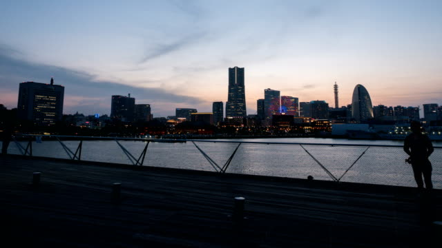 day to night time lapse of yokohama city in japan - yokohama stock videos and b-roll footage