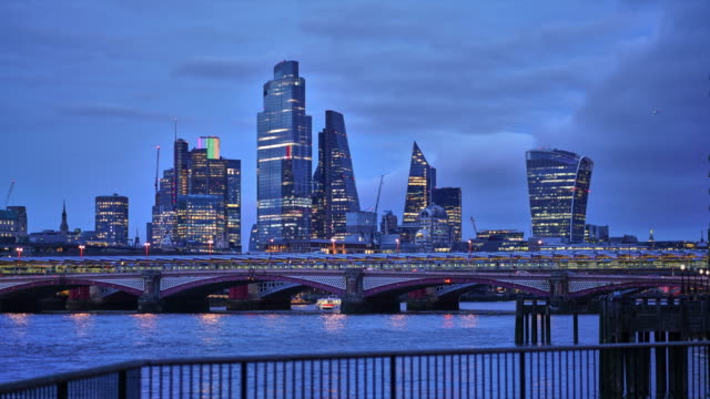 a day to night time lapse over the river thames towards the london city skyline - day stock videos & royalty-free footage