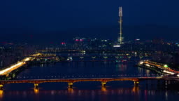 Day to night time lapse shot of Seoul cityscape with Tower, Han River and traffic on expressway, South Korea