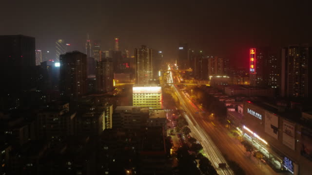 ws day to night time lapse skyline guangzhou on a smoggy day. business district - spoonfilm stock-videos und b-roll-filmmaterial