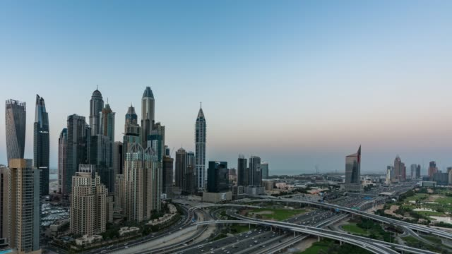 day to night /time lapse traffic in dubai - day to night stock videos & royalty-free footage