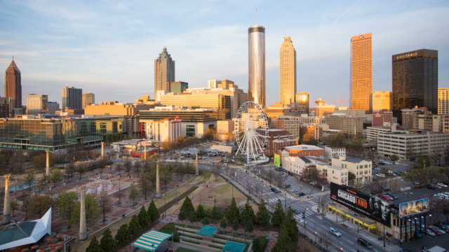 Day to night Time lapse transition - City skyline, elevated view over Downtown and the Centennial Olympic Park in Atlanta, Georgia, United States of America