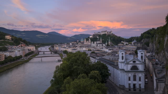day to night time lapse. view from the mönchsberg terrace to the hohensalzburg fortress and old town area of salzburg and salzach river. salzburg, austria. - traditionally austrian stock videos & royalty-free footage