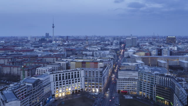 Day to night time of the Berlin skyline over Potsdamer Platz.