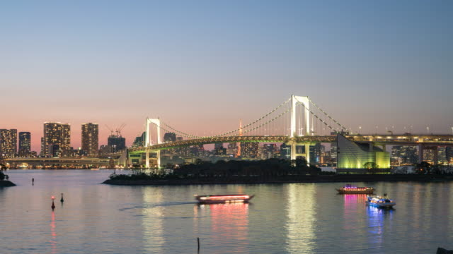 day to night time-lapse: aerial tokyo rainbow bridge - tokyo bay stock videos & royalty-free footage