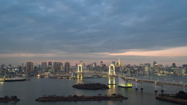 day to night time-lapse: aerial tokyo rainbow bridge - tokyo bay stock videos and b-roll footage