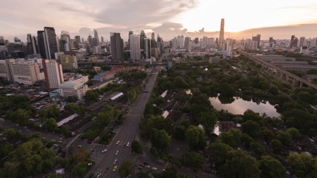 day to night timelapse aerial view of bangkok cloud skyline and skyscraper with sunset sky on financial district road bangkok city downtown thailand - day to sunset stock videos & royalty-free footage