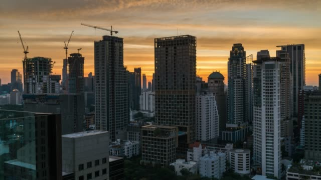 day to night timelapse aerial view of bangkok skyline and skyscraper with sunset sky on sukhumvit road center of business in bangkok city downtown thailand. - day to sunset stock videos & royalty-free footage