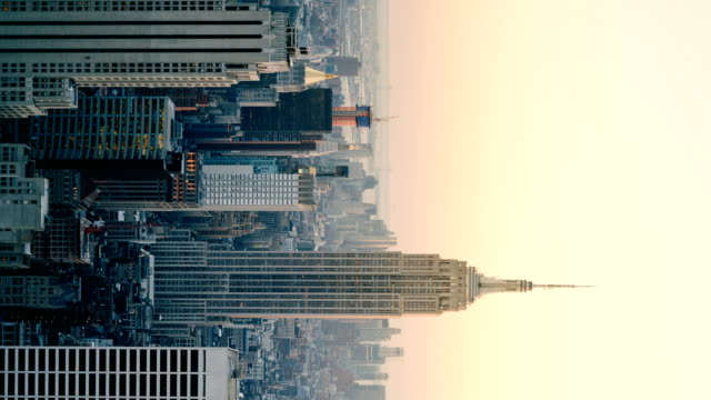 Day to night time-lapse aerial view of Empire State Building and Freedom Tower, New York, USA