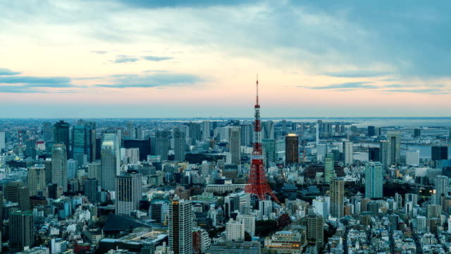 4K Day to night Time-Lapse :  Arial view of Tokyo Tower and Tokyo cityscape skyline