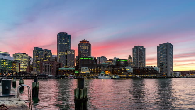 day to night time-lapse: boston cityscape skyline building with boston bay from fan pier park ma usa - boston massachusetts stock videos & royalty-free footage