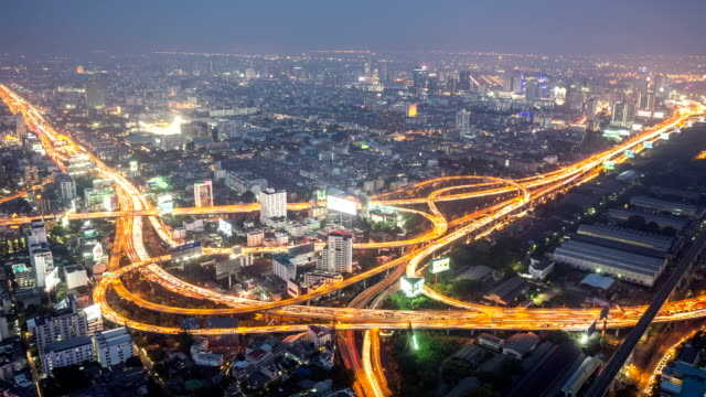 day to night time-lapse highway at dusk city life background - zoom out stock videos & royalty-free footage