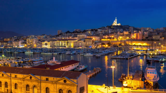 4k day to night time-lapse: marseille vieux port notre dame - cote d'azur stock videos & royalty-free footage