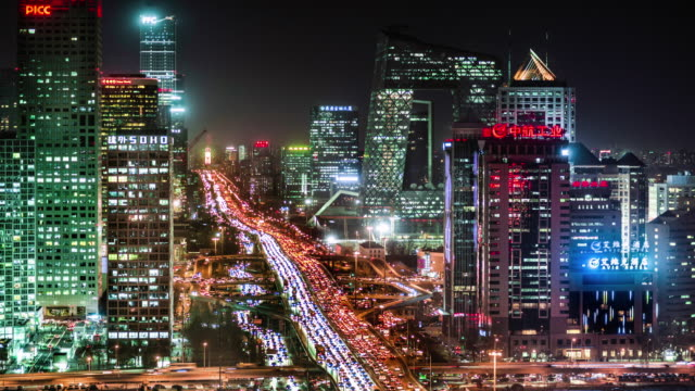vídeos de stock e filmes b-roll de day to night timelapse of beijing's financial district - pequim