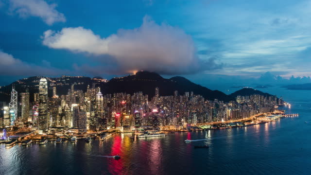 day to night timelapse of hong kong skyline and financial district