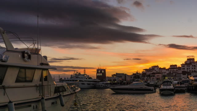 Day to night timelapse of Leisure port in Marbella at sunset