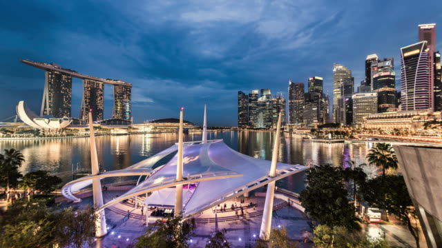 T/L day to night timelapse of outdoor theatre and  Singapore skyline