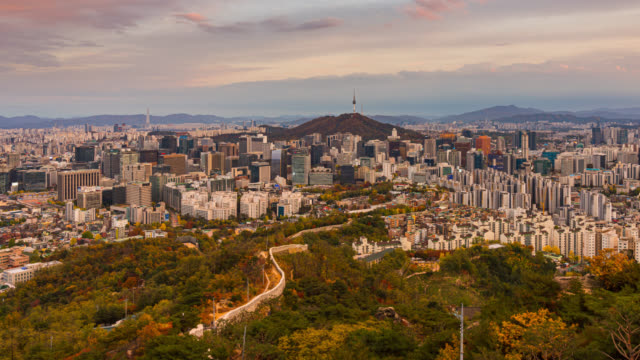 day to night timelapse of seoul downtown city skyline, aerial view of n seoul tower at namsan park in twilight sky at sunset. the best viewpoint and trekking from inwangsan mountain in seoul city, south korea - day to sunset stock videos & royalty-free footage