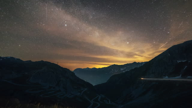 day to night timelapse of the tremola and gotthard pass with milky way - sky stock videos & royalty-free footage