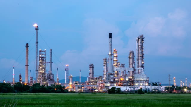 hd day to night time-lapse: oil refinery plant working - capital letter stock videos & royalty-free footage