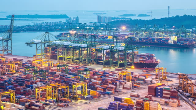 4K Day to Night time-lapse: Singapore aerial warehouse Port background