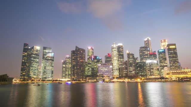 4 K Tag zur Nacht Zeitraffer: Stadtlandschaft von Singapur Marina Bay