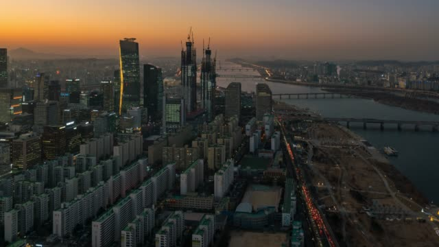 day to night timelapse sunset scence of yeouido business district at seoul city in south korea - day to sunset stock videos & royalty-free footage