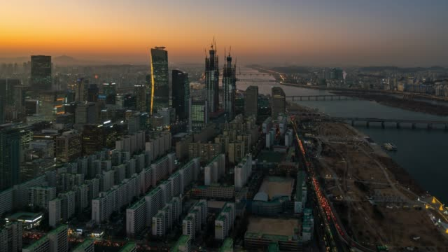 day to night timelapse sunset scence of yeouido business district at seoul city in south korea - korea stock videos & royalty-free footage