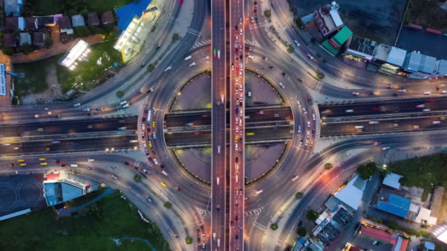 day to night timelapse : top view of circle road traffic - roundabout stock videos & royalty-free footage