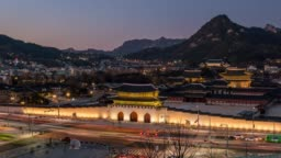 Day to night timelapse traffic in front of Gyeongbokgung Palace at Seoul city in South Korea