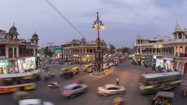 day to night time-lapse transition - busy traffic intersection in jaipur, rajasthan, india - rajasthan stock videos and b-roll footage
