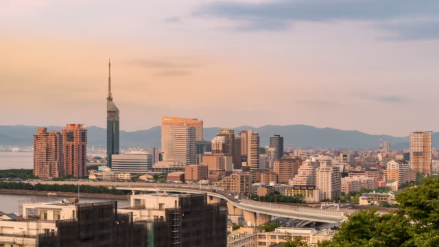 4k uhd day to night time-lapse: zoom in fukuoka tower with downtown cityscape and highway road in fukuoka city kyushu south of japan - fukuoka prefecture stock videos & royalty-free footage