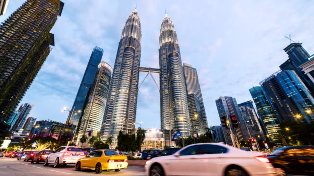 day to night tl downtown malaysia - petronas twin towers stock videos & royalty-free footage