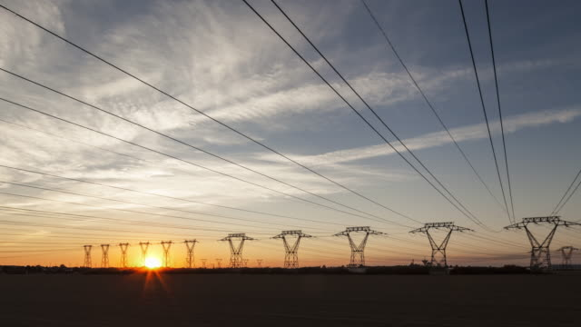 day to night tl / hyperlapse driving on road along power lines - power line stock-videos und b-roll-filmmaterial