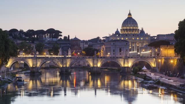 Day to night TL of Ponte Sant'Angelo and St Peter's Basilica in Rome.