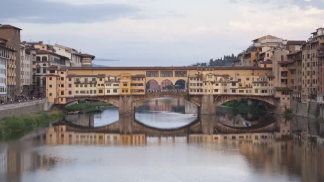 stockvideo's en b-roll-footage met day to night tl of ponte vecchio in florence, italy. - ponte