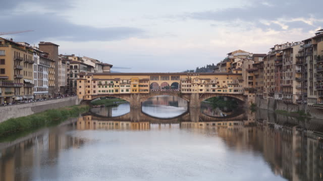 day to night tl of ponte vecchio in florence, italy. - ponte stock videos & royalty-free footage