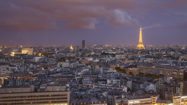day to night tl of the view over paris towards the eiffel tower - île de france stock-videos und b-roll-filmmaterial