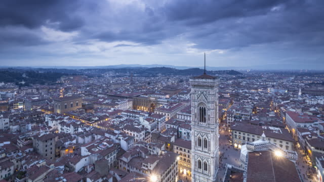 Day to night TL over Giotto's bell tower and the city of Florence, Tuscany, Italy.