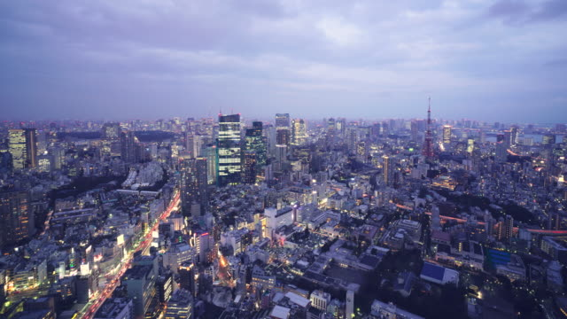 ws tl day to night tokyo skyline - dusk to night stock videos & royalty-free footage