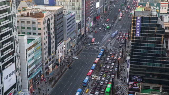 stockvideo's en b-roll-footage met day to night traffic on gangnamdaero road near gangnam subway station / gangnam-gu, seoul, south korea - straatnaambord