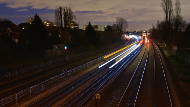 a day to night transition at rush hour on a busy north london tube and rail network - public transport stock videos & royalty-free footage