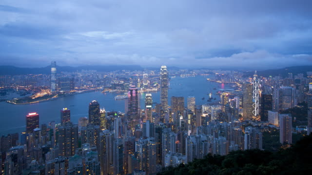 Day to night transition, View over Hong Kong from Victoria Peak, the illuminated skyline of Central sits below The Peak, Victoria Peak, Hong Kong, China, Time-lapse