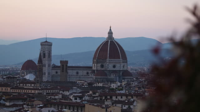 day to night view of basilica di santa maria del fiore or known as duomo - fiore stock videos & royalty-free footage