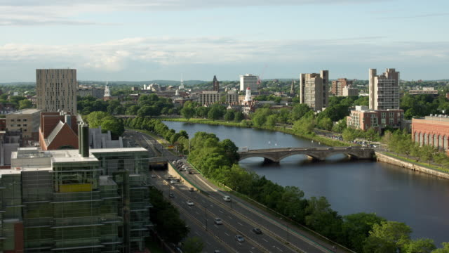 ws t/l day to night view of charles river and traffic moving on highway / boston, massachusetts, united states   - charles river stock videos & royalty-free footage