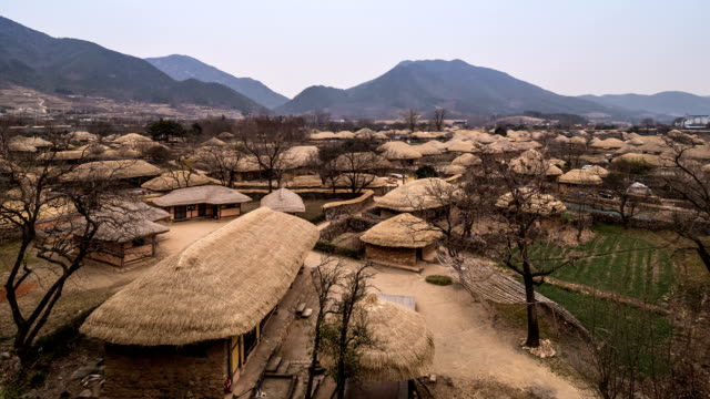 Day to night view of Chogajip (Thatched Roof traditional house) in Folk Village of Naganeubseong Town