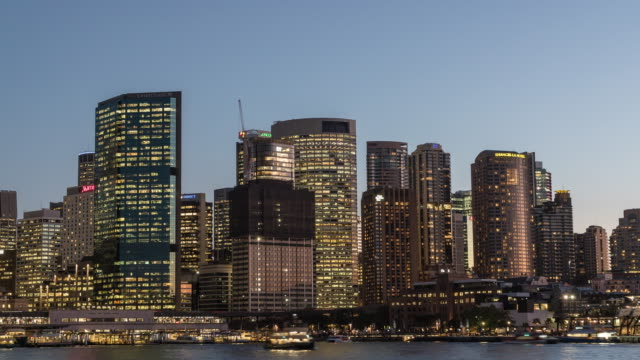 Day to night view of Circular Quay Harbor and Museum of Contemporary Art Australia