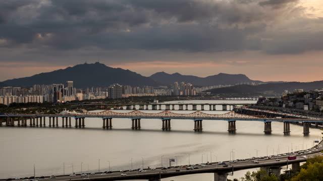 day to night view of donghodaegyo bridge and gangbyeon expressway / han river, seongdong-gu, seoul, south korea - hill stock videos & royalty-free footage